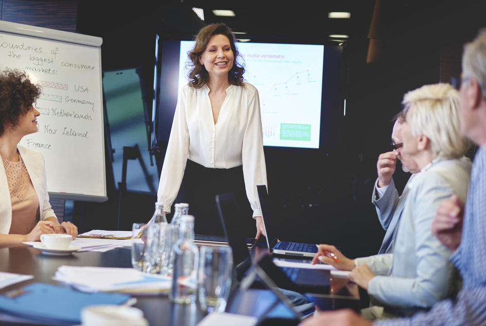 Woman making presentation in meeting.